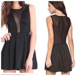 For love and Lemons black sheer skater dress